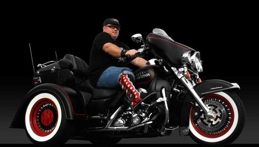 Custom Made 9 Toe Joe In His Black Buffalo Leather Knee High Boots. Made To Match His Harley Trike.