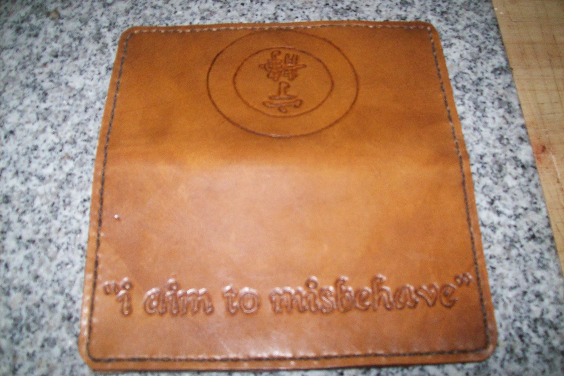 buy a hand crafted custom leather biker wallet with serenity symbol