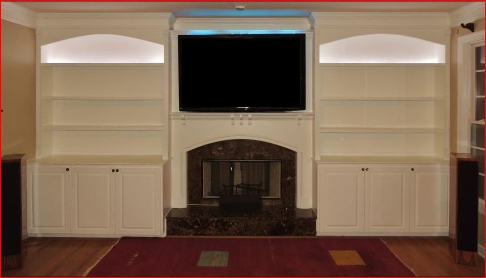 lighting bookshelves. custom made arched top bookshelves with raised panel doors and led lighting