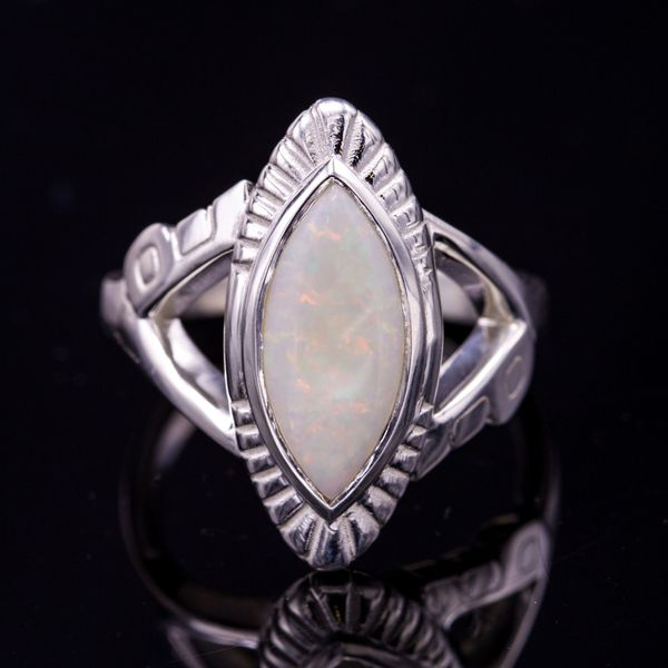 A marquise opal ring with radiating lines on the bezel and a band shape that fits the Machine Age perfectly.