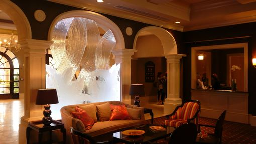 Custom Made Carved Starphire Glass And Kiln Formed Starphire Glass Sculpture At The Club House Entry Lobby At The Broken Sound Country Club.