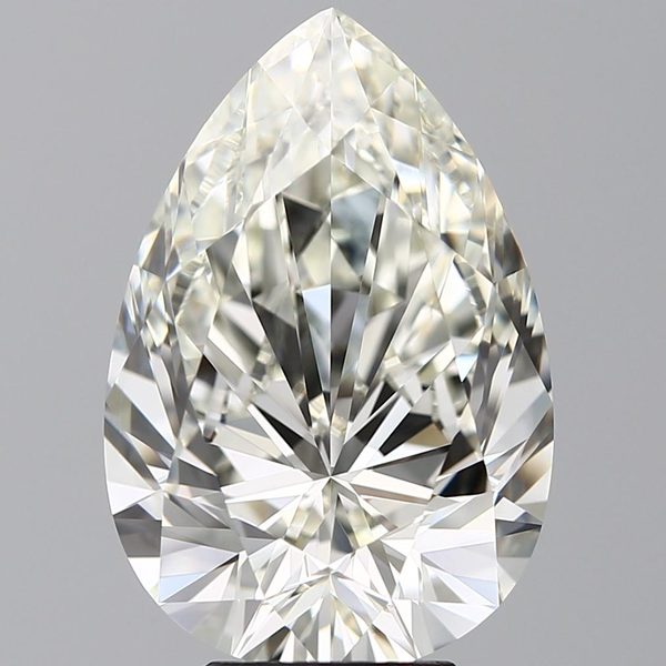 The facets near the tip of this K color pear cut diamond show much more of the yellow hue than a round cut would.