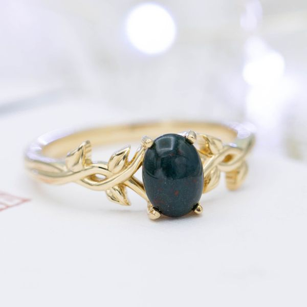 A nature-inspired bloodstone engagement ring in yellow gold.