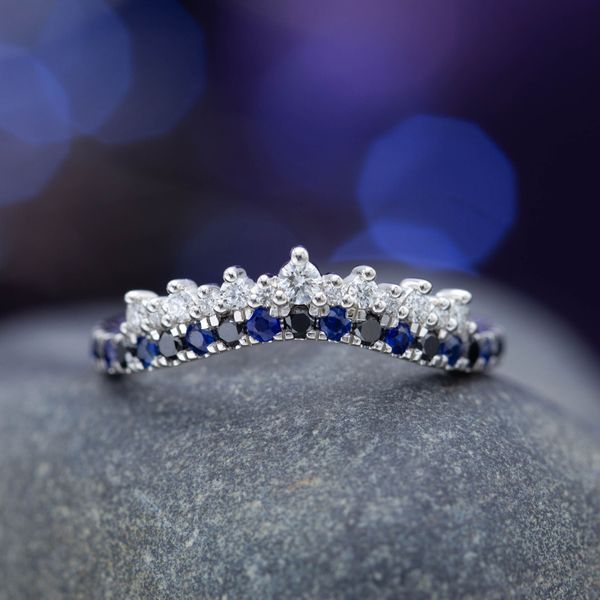 A subtle curve in sapphire and onyx with a slightly larger center diamond to hint at the tiara inspiration.
