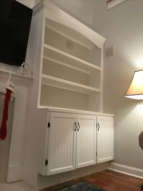 Custom Made Fireplace With Shelves And Cabinets