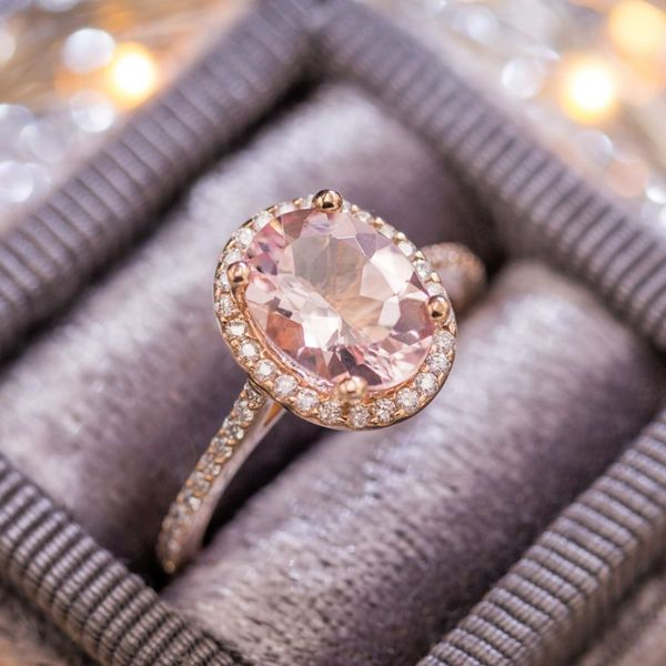 A contemporary classic in delicate rose gold with a diamond halo and pave surrounding the morganite center stone.