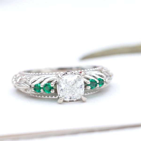 An elegant, vintage-inspired engagement ring with a cushion cut diamond center stone.