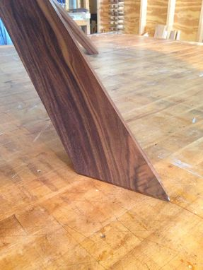 Custom Made Puzzle Leg Dining Table In Walnut