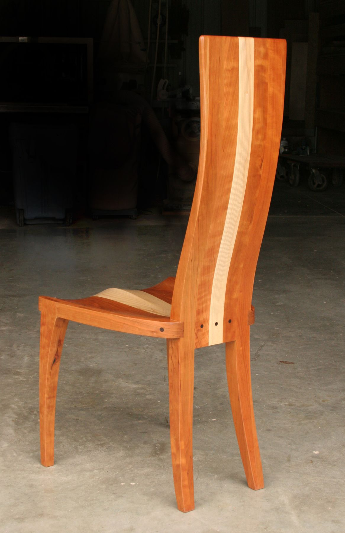 buy a handmade modern wood dining chair in cherry and curly maple  - custom made modern wood dining chair in cherry and curly maple carved seatand curved
