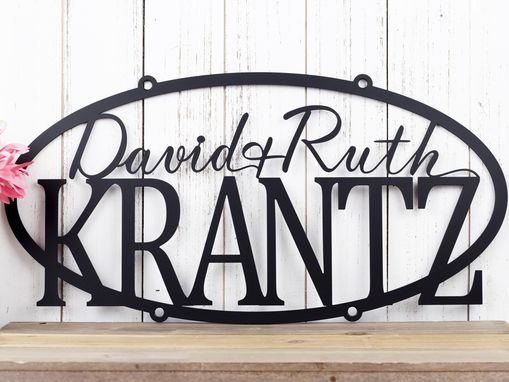 Custom Made Family Name Oval Metal Sign With First Names - Matte Black Shown