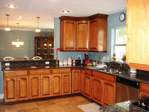 Bronze Light Fixtures With Stainless Steel Appliances
