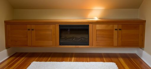 Custom Made Storage Cabinet With Fireplace