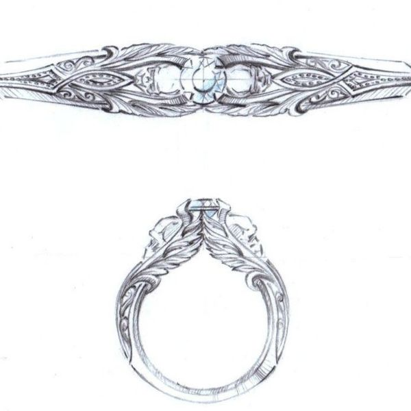 A diamond engagement ring sketch combining elegant ornamentation with a skull motif.