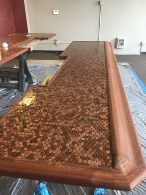 Custom Made Mahogany And Penny Bar Countertop.