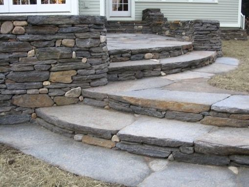 Custom Made Elevated Patio, Curved Seating Wall, Retaining Wall, And Three Sets Of Steps