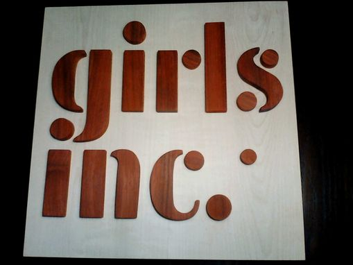 Custom Made Wood Girls Inc. Logo