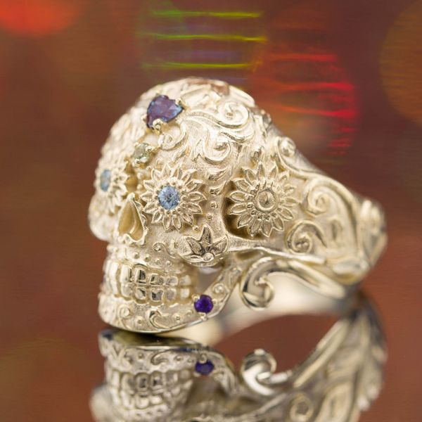A bright, bold, and beautiful sugar skull ring with accent gems adding pops of vibrant color.
