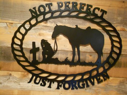 Custom Made Metal Sillouttes Of Cowboy Or Cowgirl Praying With Their Horse