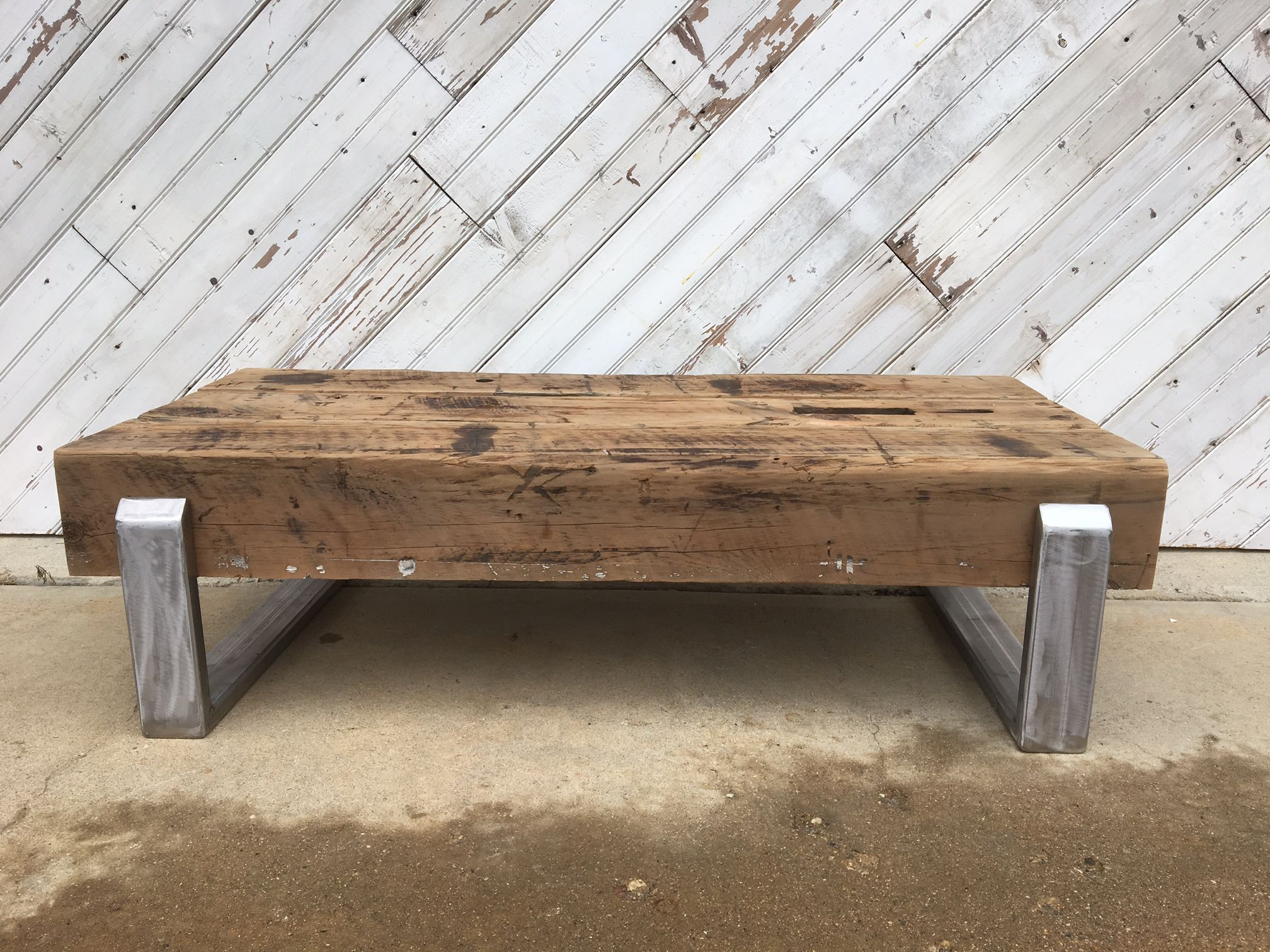 Custom reclaimed beam and stainless steel coffee table by for Reclaimed beam coffee table
