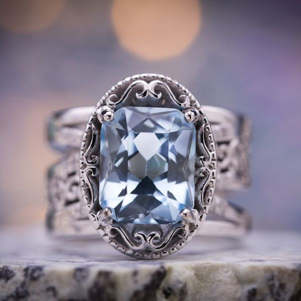 We designed this beautiful, bold aquamarine ring with tons of vintage detailing and a wide, multi-strand band. The centerpiece is a stunning, custom precision cut radiant aquamarine.