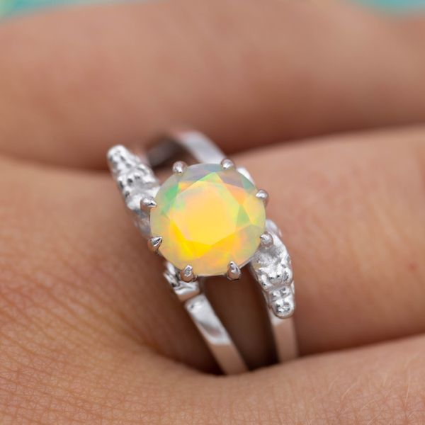 This unusual, faceted opal's warm colors almost seem to glow.
