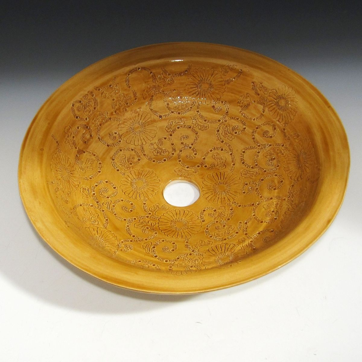 Thrown Pottery Sink With Engraved Chrysanthemum Design In Golden Yellow