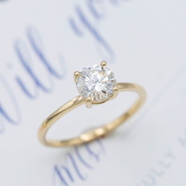 Sweet simplicity! A delicate solitaire setting for an 0.91ct round cut center stone.
