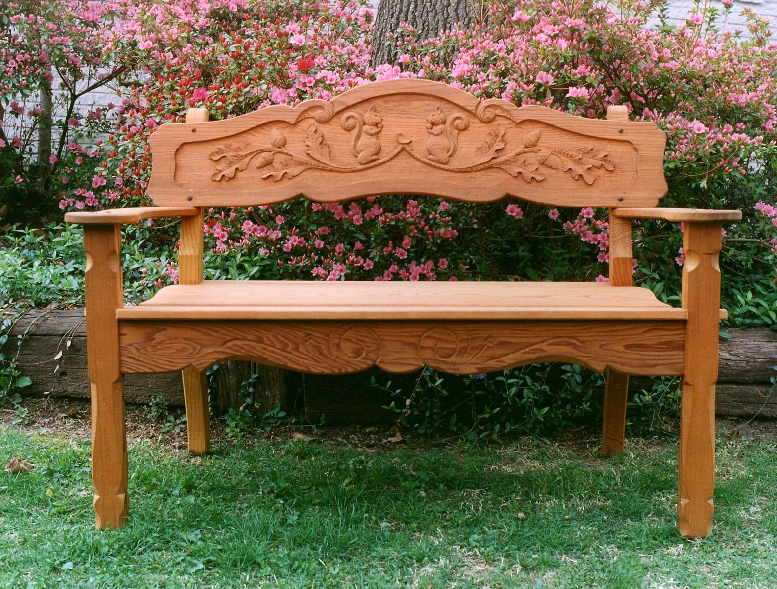 buy a hand made handcarved cyprus or mahogany garden bench made to order from grayson artistry in wood custommadecom