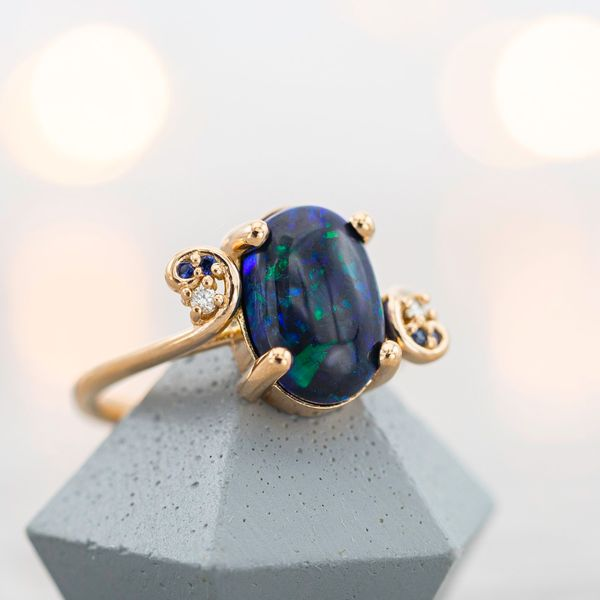 This black opal's coloring is mostly a dark, vivid blue.