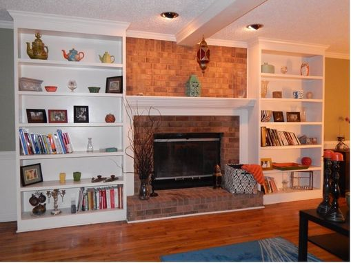 Custom Made Bookshelves Flanking A Fireplace