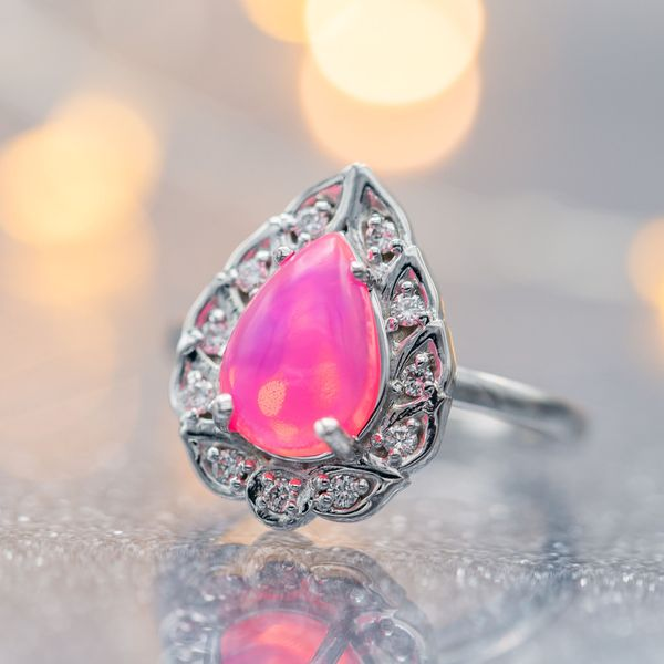 This engagement ring's luminescent, bubblegum pink opal makes a beautiful, unusual statement.