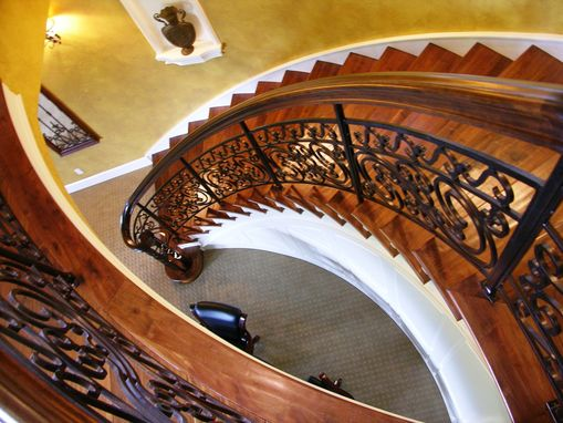 Custom Made Curved Stair With Textured Walnut Treads@
