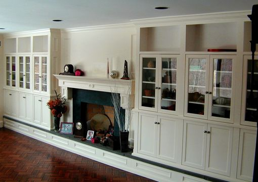 Custom Made Display Cabinetry With Fireplace Surround