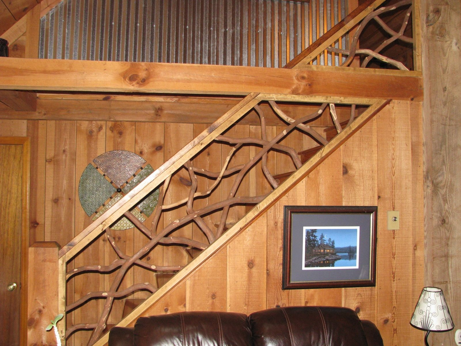 Handmade mountain laurel interior railing with distressed wood hand rails by rhodo creations for Wooden handrails for stairs interior