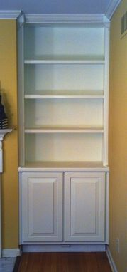 Custom Made Built In Bookcase With Hidden Storage
