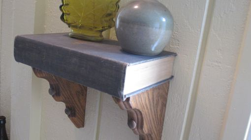 Custom Made Floating Shelf Made With A Repurposed Vintage Book