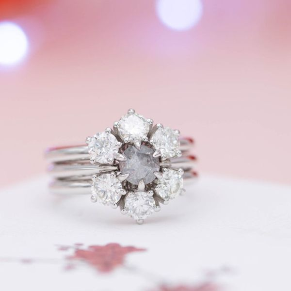 This three ring set fits together to surround the smoky gray salt & pepper diamond with a snowflake-inspired halo of colorless diamonds.
