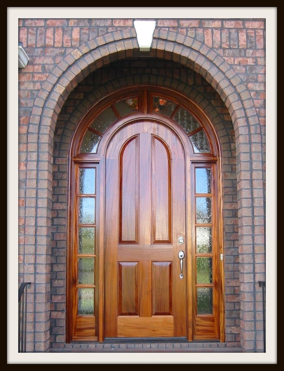 Custom Round Doors : Hand made mahogany round top door by the looking glass