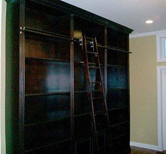 Custom Made Bookcases And Rolling Library Ladder