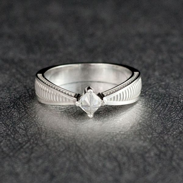 b3fdc32440408e The princess cut moissanite center stone in this engagement ring is set  upside down to look even more like the resurrection stone from Harry Potter.