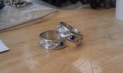 Custom Made Loopy Ring With Diamond And Sapphire