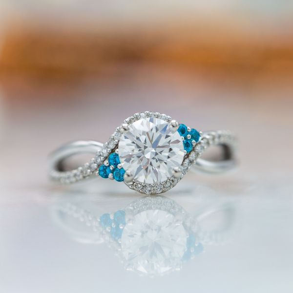 This diamond ring packs a whole ton of sparkle and adds a bit of color with topaz accents.