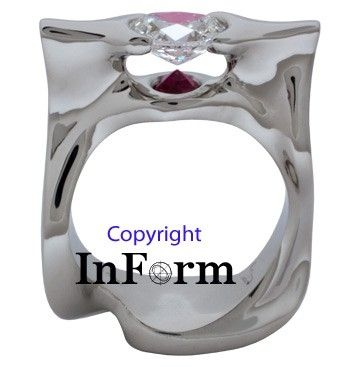 Custom Made White Gold Ring With Oval Diamond And Inverted Ruby