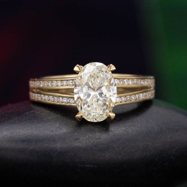 Even a perfectly colorless diamond would reflect hints of yellow from this beautiful gold setting, so the ring hides the J color of this beautiful diamond.