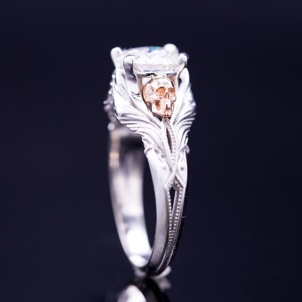 d8d1cb40566038 A vintage-inspired diamond ring with rose gold skulls nestled into white  gold wings.