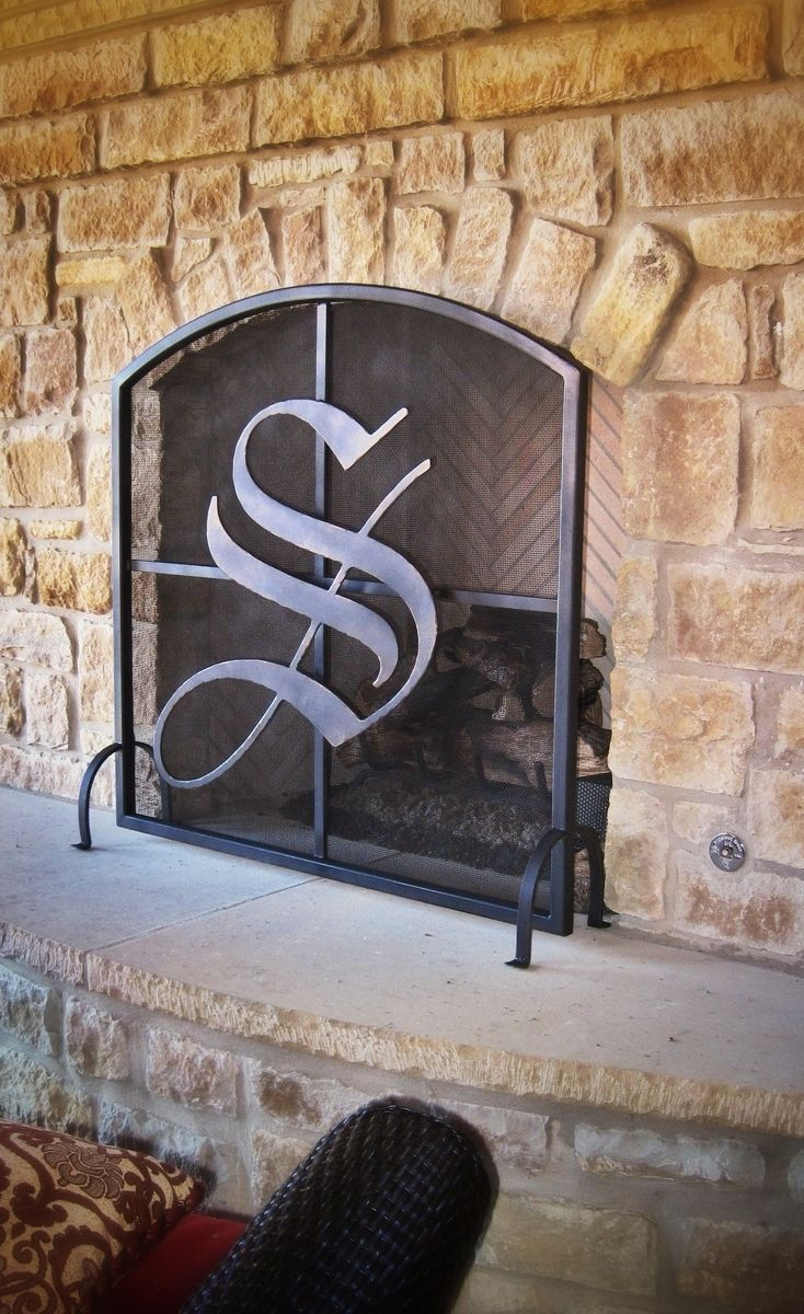 Freestanding fireplace screen with plasma cut letter intial. We used a bronze patina finish.…