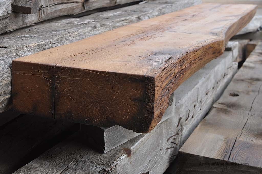 This rustic mantel shelf was originally a large sleeper beam that supported an old granary near Henderson