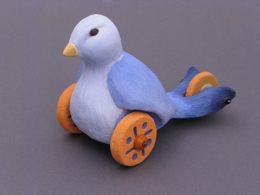 Custom Made Ceramic Toy Bluebird With Wheels