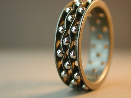 Custom Made Titanium, 3-Channel, Perforated Ring With Stainless Steel Balls