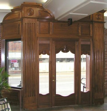 Custom Made Carved Door With Sidelights And Millwork With Fluted Pilasters